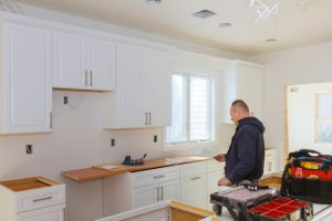 installing-new-modern-kitchen-cabinet_73110-8032